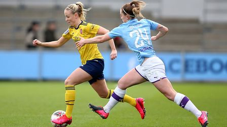 Manchester City's Keira Walsh (right) and Arsenal's Beth Mead battle for the ball during the FA Wome