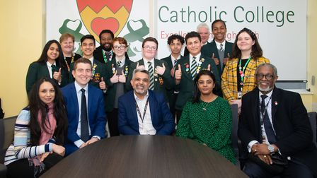 Staff and pupils of Newman Catholic College celebrate campaign for lights win with Brent chiefs incl