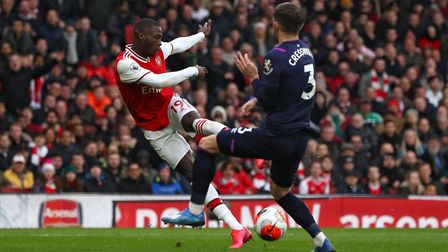 Arsenal's Nicolas Pepe in action with West Ham United's Aaron Cresswell during the Premier League ma