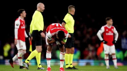 Arsenal's Pierre-Emerick Aubameyang (centre) appears dejected after the final whistle at the Europa