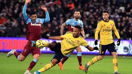 Arsenal's Pierre-Emerick Aubameyang (centre) scores his side's third goal of the game during the Pre