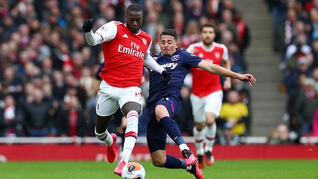 Arsenal's Nicolas Pepe (left) and West Ham United's Pablo Fornals battle for the ball during the Pre