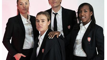 Arsenal's Hector Bellerin with members of the women's squad in their 424 suits ahead of the Conti Cu