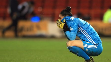 Arsenal goalkeeper Manuela Zinsberger appears dejected after the final whistle of the FA Women's Con