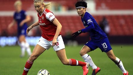 Arsenal's Leah Williamson (left) and Chelsea's Ji So-yun battle for the ball during the FA Women's C