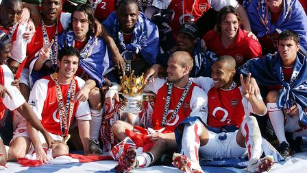 Arsenal players celebrate with the e Barclaycard Premiership trophy after their match against Leices