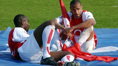 Arsenal's Thierry Henry (right) and Sol Campbell celebrate winning the Barclaycard Premiership trop