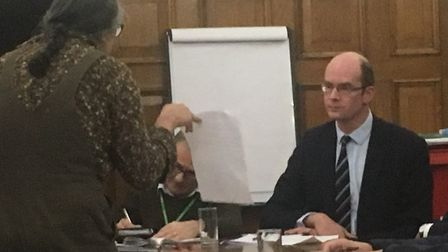 An angry tenant remonstrates with Partners chief exec Tom Irvine. Picture: Lucas Cumiskey