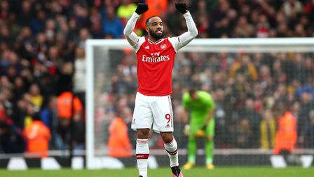 Arsenal's Alexandre Lacazette (centre) celebrates after his side's first goal of the game is re-allo