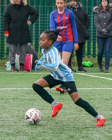 A young Brent Schools football player in action on International Women's Day. Picture: Nabeel Baig