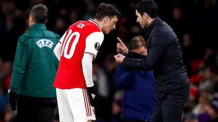 Arsenal manager Mikel Arteta (right) and Mesut Ozil talk before going into extra time during the Eur