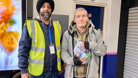 Jorawar 'Jay' Singh Rathour gives out a man in Finsbury Park, who was happy to be pictured. Picture: