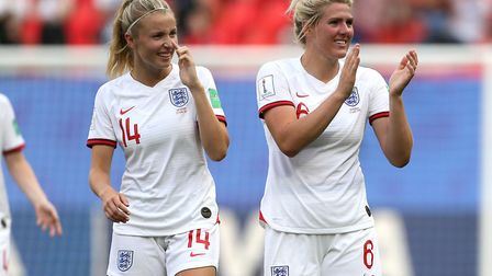 England's Leah Williamson (left) and team-mates Millie Bright celebrate after the final whistle duri