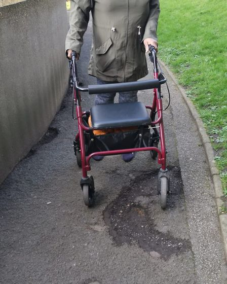 Jacqueline Mugridge struggles to navigate the footpaths in Spa Green Estate. Picture: Thomas Cooper