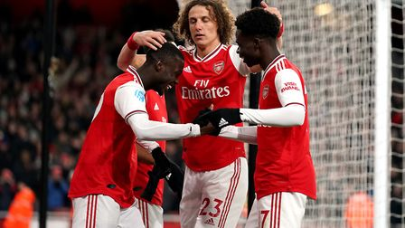 Arsenal's Nicolas Pepe (left) celebrates scoring his side's second goal of the game with team-mates
