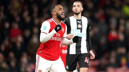 Arsenal's Alexandre Lacazette (left) celebrates scoring his side's fourth goal of the game during th