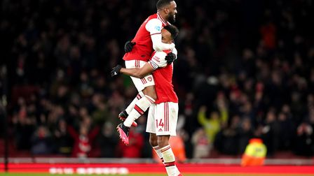 Arsenal's Alexandre Lacazette (left) celebrates after the final whistle with team-mate Pierre-Emeric