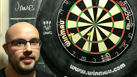Adam Finch helped Doyles defeat N19 in the Archway Darts League (pic James Martin)