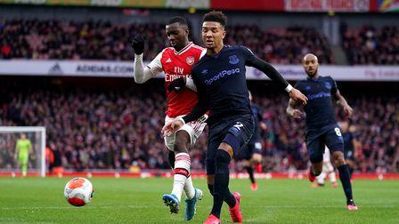 Arsenal's Eddie Nketiah (left) and Everton's Mason Holgate (right) battle for the ball during the Pr