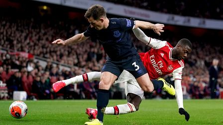 Everton's Leighton Baines (left) and Arsenal's Nicolas Pepe (right) battle for the ball during the P