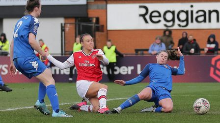 Caitlin Foord of Arsenal scores the first goal for her team and celebrates during Arsenal Women vs L