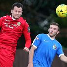 Jordan Clark of Hornchurch and George Moore of Harrow compete for a header during an FA Cup tie (pic