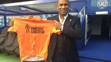 Les Ferdinand poses with a Prostate Cancer UK shirt. Picture: Prostate Cancer UK