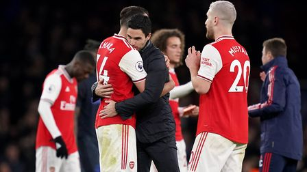 Arsenal manager Mikel Arteta (centre) celebrates victory with Granit Xhaka (left) after the final wh