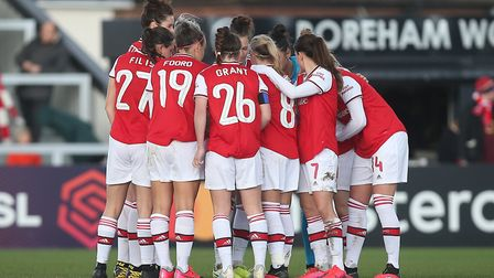 Arsenal players huddle before a match at Meadow Park (pic Gavin Ellis/TGS Photo)