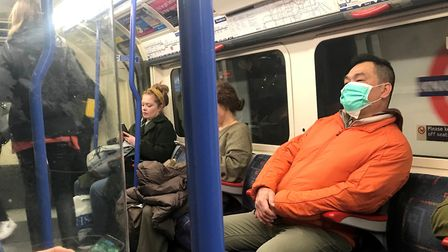 A man on the Piccadilly line wearing a face mask. Picture: Kirsty O'Connor/ PA Wire