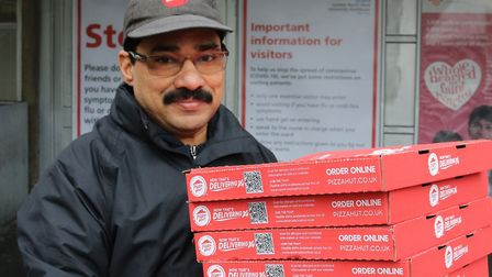 Pizza Hut manager Mohammad Shabbire hand delivers a batch to Northwick Park hospital during coronavi