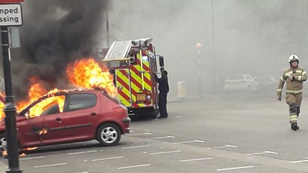 Firefighters tackle blazing car in Upper Holloway. Picture: John Dickson