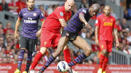 Liverpool's Jonjo Shelvey in action with Arsenal's Abou Diaby (right) during the Barclays Premier Le