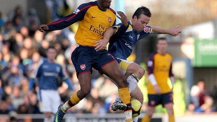 Cardiff City's Gavin Rae and Arsenal's Abou Diaby (left) battle for the ball. Picture: Nick Potts/PA