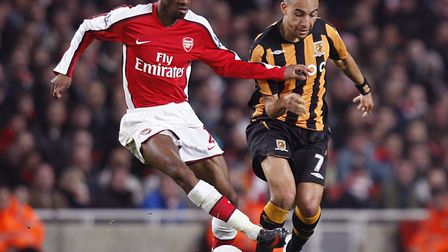 Arsenal's Abou Diaby (left) and Hull City's Craig Fagan (right) battle for the ball. Picture: Sean D