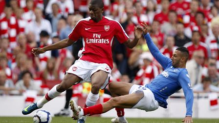 Arsenal's Abou Diaby (left) and Portsmouth's Nadir Belhadj (right) battle for the ball. Picture: Sea