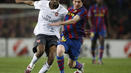 Arsenal's Abou Diaby (left) and Barcelona's Lionel Messi battle for the ball. Picture: Nick Potts/PA