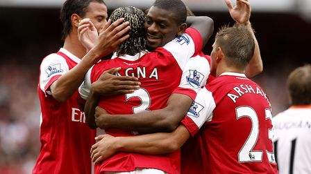 Arsenal's Abou Diaby (centre right) celebrates scoring his side's fourth goal. Picture: Sean Dempsey