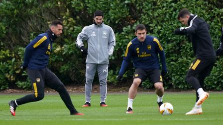 Arsenal manager Mikel Arteta (second left) during the training session at London Colney. Picture: Jo