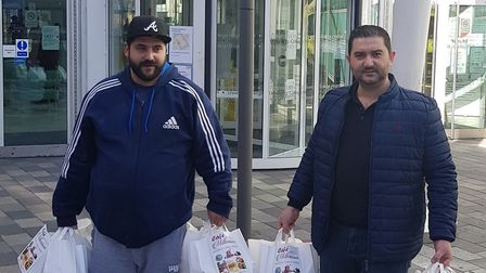 Yildirim and a colleague delivering food to University College Hospital.