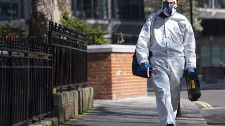 A man wearing a protective face mask and clothing in London. Picture: Victoria Jones/ PA
