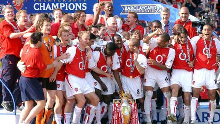Arsenal players celebrate with the Barclaycard Premiership trophy after their match against Leiceste
