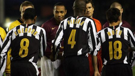 Juventus' Patrick Vieira shakes hands with his former team-mates Arsenal's Thierry Henry (centre lef