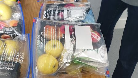 Food packages for homeless people self-isolating. Picture: Jess Turtle