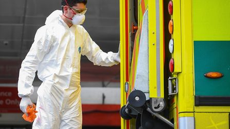 A paramedic wearing personal protective equipment as the UK continues in lockdown to help curb the s