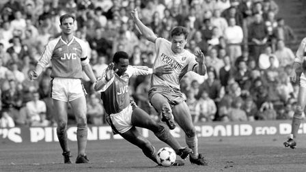 Arsenal's David Rocastle (c) battles for the ball with Norwich City's Dean Coney (r) as teammate Ste