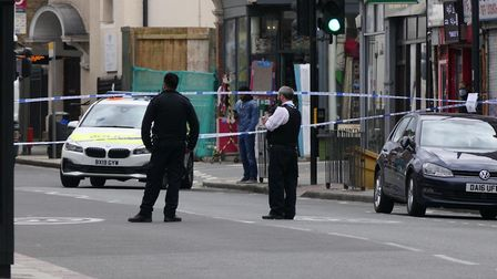 Police after an armed raid in Willesden High Road on April 2. Picture: David Nathan