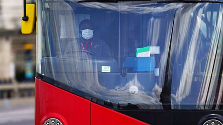 A London bus driver wearing a face mask, following the news that ten public transport workers in Lon