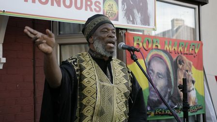 Delroy Washington leads the crowds with a selection of Bob Marley classics at the plaque unveiling i