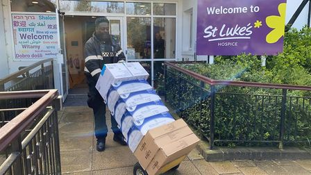 A council officer out making food parcel deliveries. Picture: Brent Council